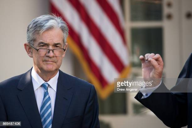 Jerome Powell US President Donald Trump's nominee for the chairman of the Federal Reserve looks on as President Trump speaks during a press event in...