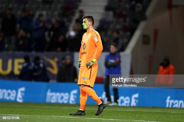 Jerome Prior of Bordeaux has a laser pointed in his face during the french League Cup match Round of 16 between Toulouse and Bordeaux on December 12...