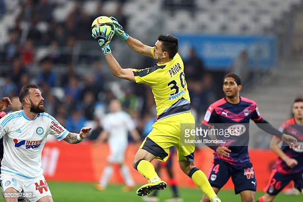 Jerome Prior of Bordeaux makes a save under pressure from Steven Fletcher of Marseille during the French League 1 match between Olympique de...