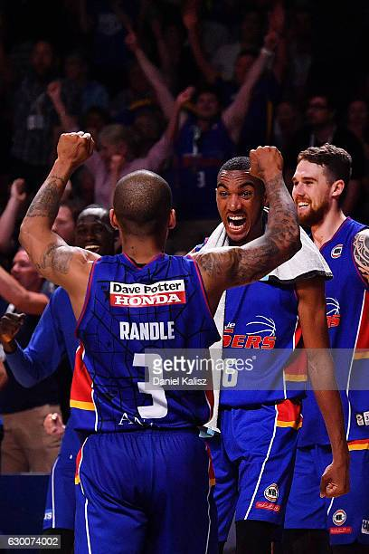 Jerome Randle and Terrance Ferguson of the Adelaide 36ers celebrate after the final whistle during the round 11 NBL match between Adelaide 36ers and...