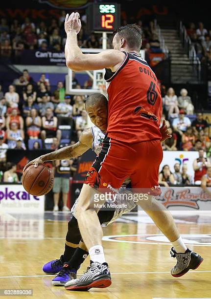 Jerome Randle of the 36ers runs into Andrew Ogilvy of the Hawks during the round 17 NBL match between the Illawarra Hawks and the Adelaide 36ers at...
