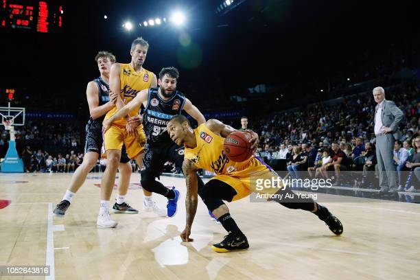 Jerome Randle of the Kings drives against Jarrad Weeks of the Breakers during the round two NBL match between the New Zealand Breakers and the Sydney...