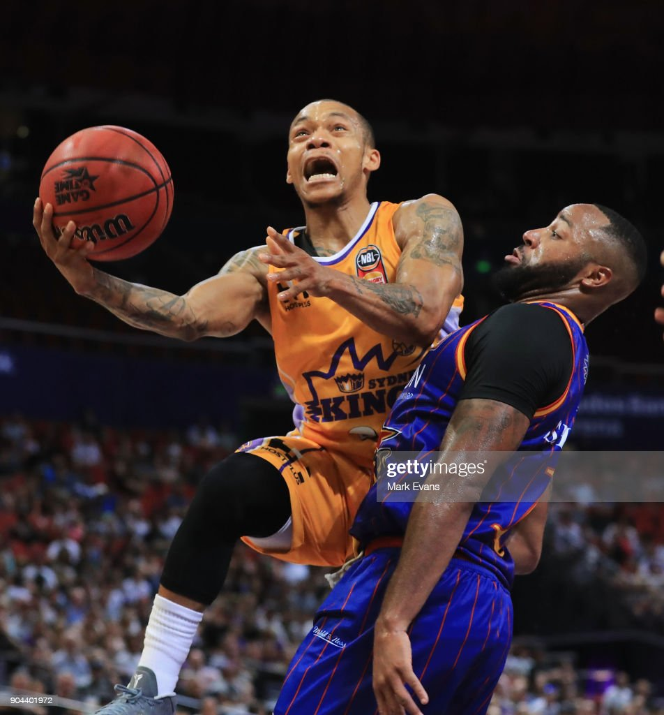Jerome Randle of the Sydney Kings shoots for the basket as Shannon Shorter of the Adelaide 36ers blocks during the round 14 NBL match between the Sydney Kings and the Adelaide 36ers at Qudos Bank Arena on January 13, 2018 in Sydney, Australia.
