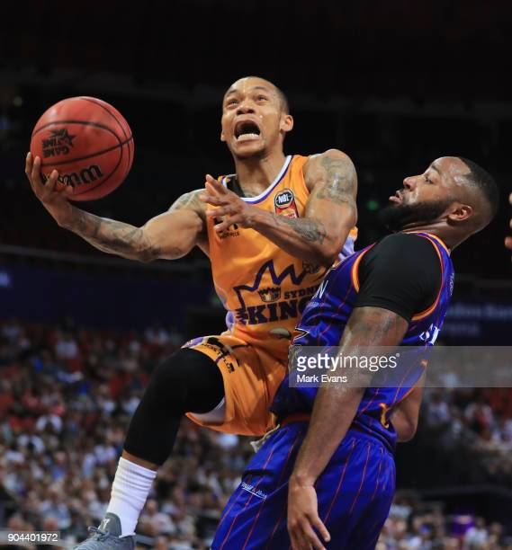 Jerome Randle of the Sydney Kings shoots for the basket as Shannon Shorter of the Adelaide 36ers blocks during the round 14 NBL match between the...