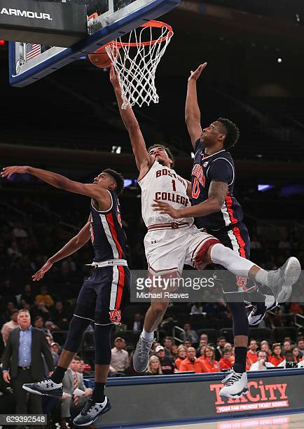 Jerome Robinson of the Boston College Eagles puts up a layup defended by Horace Spencer and TJ Lang of the Auburn Tigers in the first half of the...