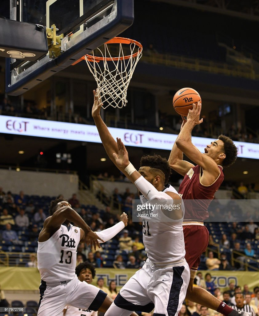 Jerome Robinson #1 of the Boston College Eagles puts up a shot over Terrell Brown #21 of the Pittsburgh Panthers in the second half during the game at Petersen Events Center on February 13, 2018 in Pittsburgh, Pennsylvania.