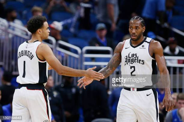 Jerome Robinson of the LA Clippers celebrates with Kawhi Leonard against the Orlando Magic during the second half at Amway Center on January 26 2020...