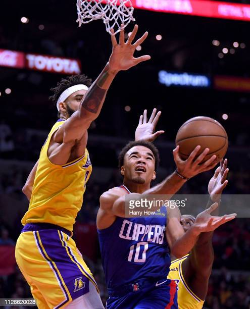 Jerome Robinson of the LA Clippers scores as he is fouled between JaVale McGee and Lance Stephenson of the Los Angeles Lakers during a 123120 Laker...