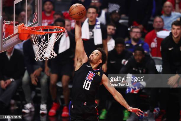 Jerome Robinson of the Los Angeles Clippers dunks the ball against the Golden State Warriors during the second quarter of Game Four of Round One of...