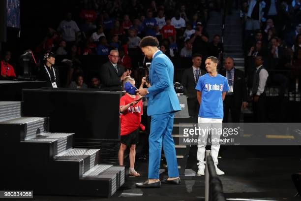Jerome Robinson puts on the LA Clippers 2018 Draft hat after being selected thirteenth by the LA Clippers on June 21 2018 at Barclays Center during...