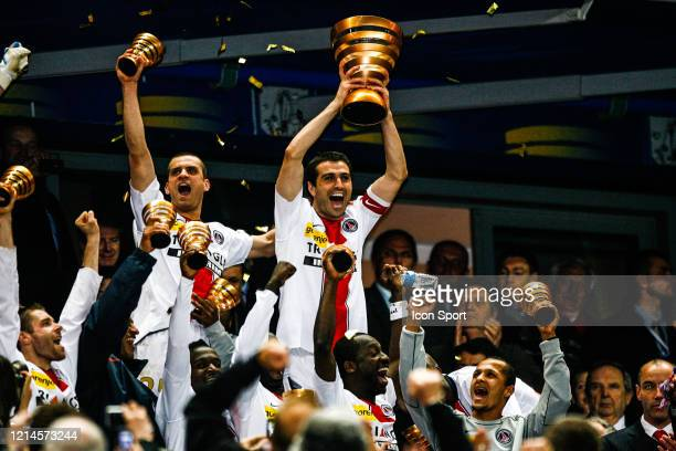 Jerome ROTHEN and Pedro PAULETA of PSG left the trophy during the League Cup Final match between RC Lens and Paris Saint Germain at Stade de France...