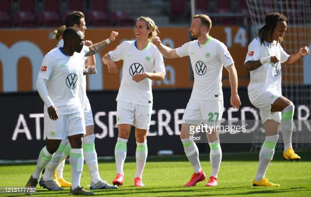 Jerome Roussillon Daniel Ginczek Felix Klaus Maximilian Arnold and Kevin Mbabu of VfL Augsburg celebrate after Daniel Ginczek scored their team's...