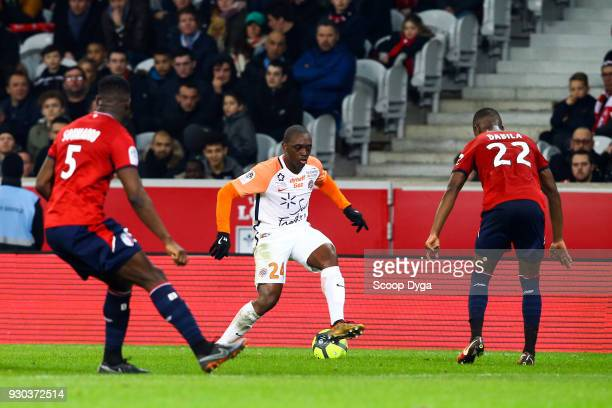 Jerome Roussillon of Montpellier Adama Soumaoro of Lille and Kouadio Yves Dabila of Lille during the Ligue 1 match between Lille OSC and Montpellier...