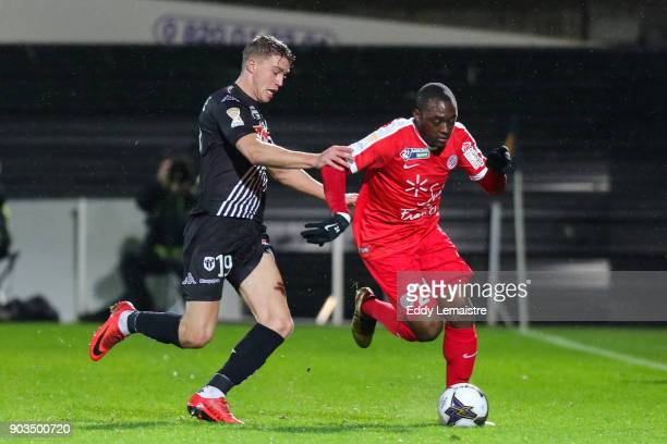 Jerome Roussillon of Montpellier and Baptiste Guillaume of Angers during the League Cup match between Angers and Montpellier at Stade Jean Bouin on...