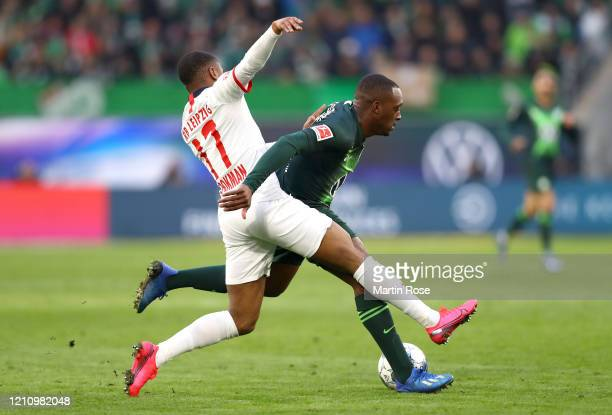 Jerome Roussillon of VfL Wolfsburg battles for possession with Ademola Lookman of RB Leipzig during the Bundesliga match between VfL Wolfsburg and RB...