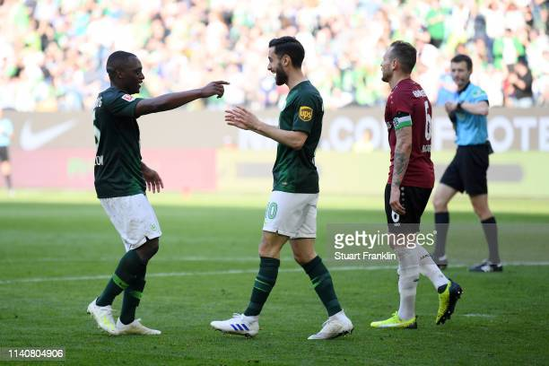Jerome Roussillon of VfL Wolfsburg celebrates after scoring his team's third goal during the Bundesliga match between VfL Wolfsburg and Hannover 96...