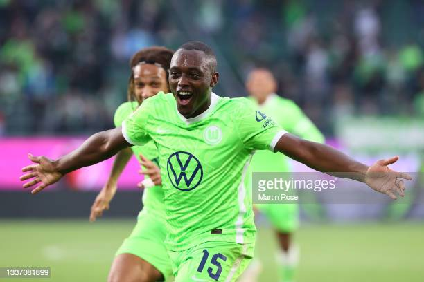 Jerome Roussillon of VfL Wolfsburg celebrates after scoring their sides first goal during the Bundesliga match between VfL Wolfsburg and RB Leipzig...