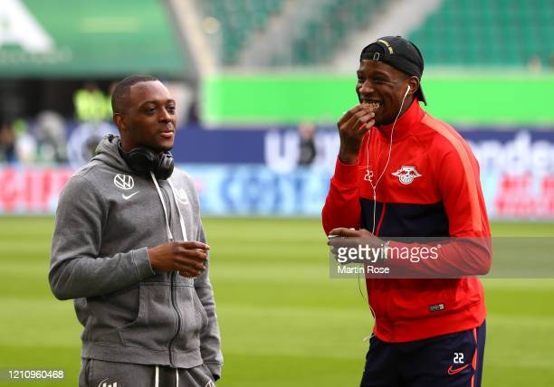 Jerome Roussillon of VfL Wolfsburg speaks to Nordi Mukiele of RB Leipzig on the pitch prior to the Bundesliga match between VfL Wolfsburg and RB...