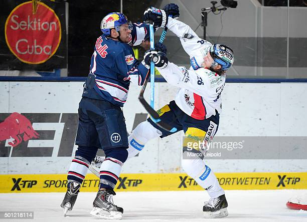Jerome Samson of EHC Red Bull Muenchen and Florian Busch of the Eisbaeren Berlin during the game between EHC Red Bull Muenchen and the Eisbaeren...