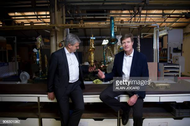 Jerome Selmer general director of Selmer musical instruments manufacturer poses with Louis Gordon chairman of Argos Soditic a financial institute...