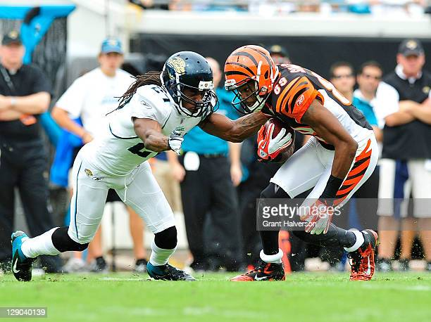 Jerome Simpson of the Cincinnati Bengals and Rashean Mathis of the Jacksonville Jaguars at EverBank Field on October 9, 2011 in Jacksonville,...