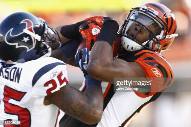 Jerome Simpson of the Cincinnati Bengals hauls in a pass against Kareem Jackson of the Houston Texans during their game at Paul Brown Stadium on...