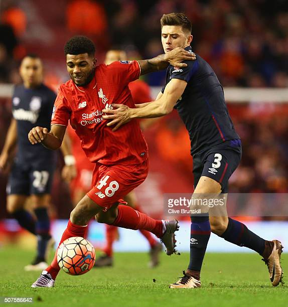 Jerome Sinclair of Liverpoo holds off Aaron Cresswell of West Ham United during the Emirates FA Cup Fourth Round match between Liverpool and West Ham...