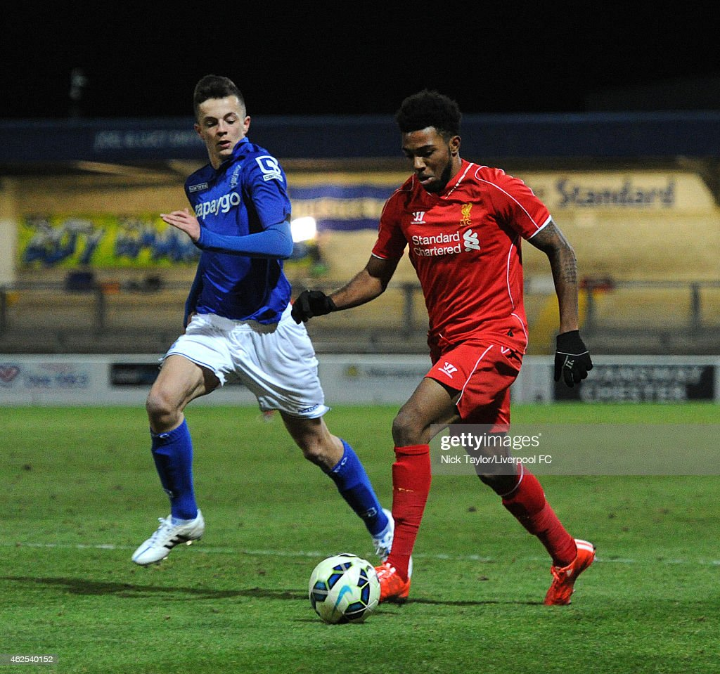 Jerome Sinclair of Liverpool and Josh Martin of Birmingham City in action during the FA Youth Cup 5th Round match between Liverpool and Birmingham City at The Swansway Chester Stadium on January 30, 2015 in Chester, England.