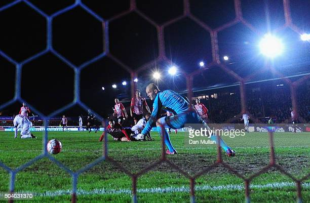 Jerome Sinclair of Liverpool beats goalkeeper Robert Olejnik of Exeter City to score their first and equalising goal during the Emirates FA Cup third...