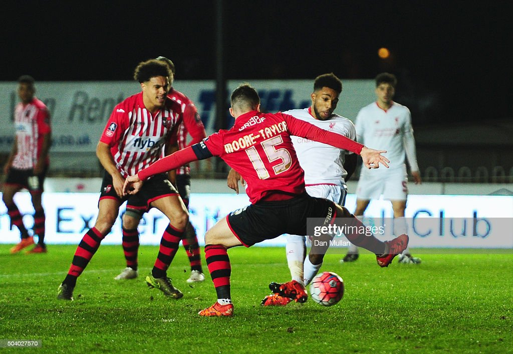 Jerome Sinclair of Liverpool beats Jordan Moore-Taylor of Exeter City (15) to score their first and equalising goal during the Emirates FA Cup third round match between Exeter City and Liverpool at St James Park on January 8, 2016 in Exeter, England.