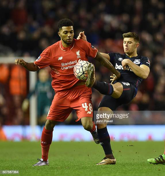Jerome Sinclair of Liverpool competes with Aaron Cresswell of West Ham United during The Emirates FA Cup Fourth Round between Liverpool and West Ham...