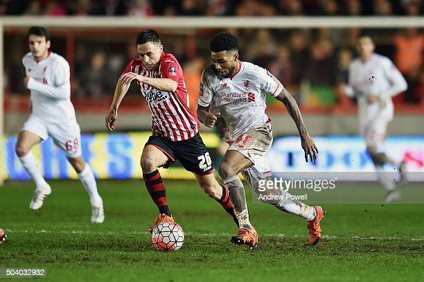 Jerome Sinclair of Liverpool competes with Jordan Tillson of Exeter City during the Emirates FA Cup third round match between Exeter City and...