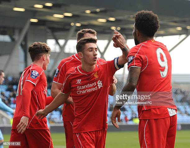 Jerome Sinclair of Liverpool is congratulated for his assist to Harry Wilson's goal by captain Cameron Brannagan during the Barclays U21 Premier...
