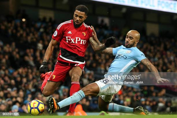 Jerome Sinclair of Watford and Fabian Delph of Manchester City during the Premier League match between Manchester City and Watford at Etihad Stadium...