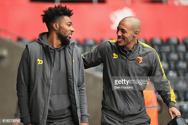 Jerome Sinclair of Watford and Nordin Amrabat of Watford arrive at the stadiium prior to kick off during the Premier League match between Swansea...