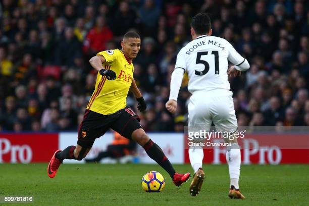 Jerome Sinclair of Watford and Roque Mesa of Swansea City in action during the Premier League match between Watford and Swansea City at Vicarage Road...