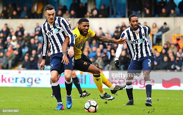 Jerome Sinclair of Watford and Shaun Williams of Millwall battle for possession during The Emirates FA Cup Fourth Round match between Millwall and...