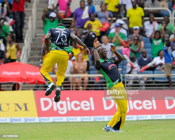 Jerome Taylor and Andre Russell of Jamaica Tallawahs celebrates the dismissal of Marlon Samuels of Antigua Hawksbills during a match between Jamaica...