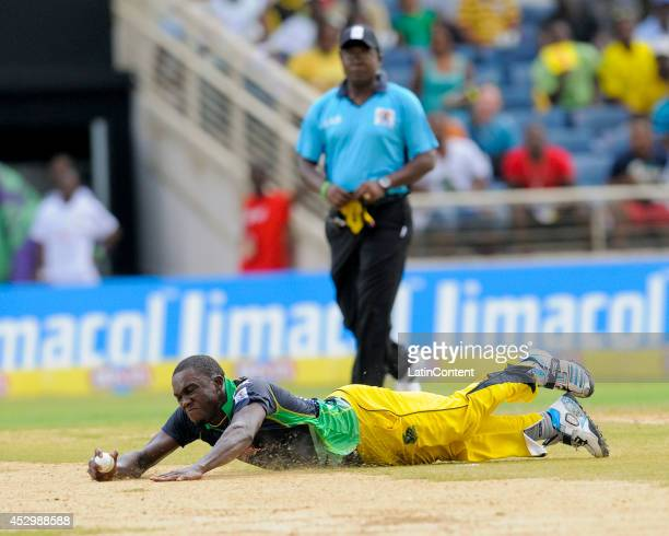 Jerome Taylor of Jamaica Tallawahs takes the catch to dismiss Ben Dunk of Antigua Hawksbills during a match between Jamaica Tallawahs and Antigua...