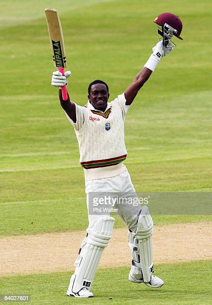 Jerome Taylor of the West Indies celebrates reaching his century during day four of the First Test match between New Zealand and the West Indies at...
