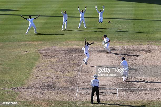 Jerome Taylor of West Indies appeals successfully for the lbw wicket of Ian Bell of England uring day two of the 3rd Test match between West Indies...