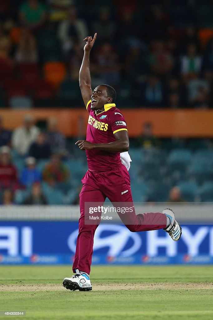 Jerome Taylor of West Indies celebrates the wicket of Tinashe Panyangara of Zimbabwe during the 2015 ICC Cricket World Cup match between the West Indies and Zimbabwe at Manuka Oval on February 24, 2015 in Canberra, Australia.