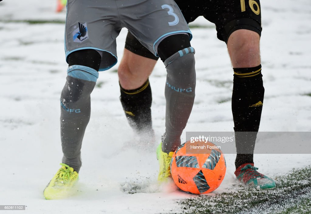 Jerome Thiesson #3 of Minnesota United FC passes the ball away from Chris McCann #16 of Atlanta United FC during the second half of the match on March 12, 2017 at TCF Bank Stadium in Minneapolis, Minnesota. Atlanta defeated Minnesota 6-1.