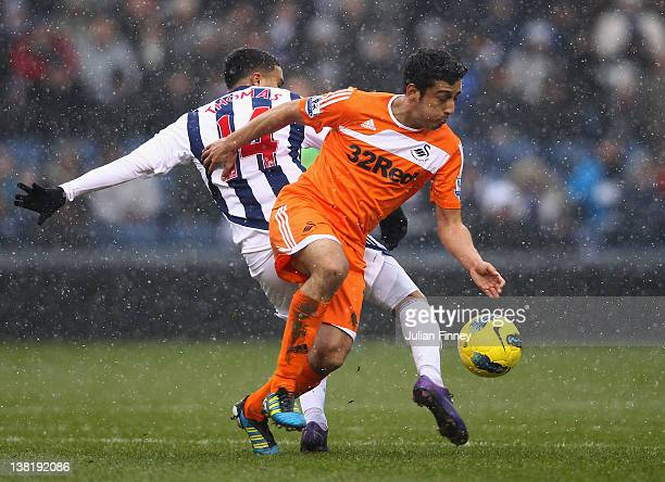 Jerome Thomas of West Brom tangles with Joe Allen of Swansea during the Barclays Premier League match between West Bromwich Albion and Swansea City...