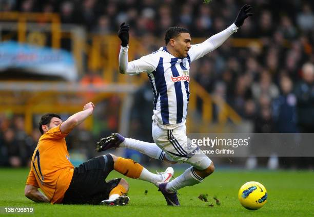 Jerome Thomas of West Bromwich Albion is tackled by Matt Jarvis of Wolverhampton Wanderers during the Barclays Premier League match between...