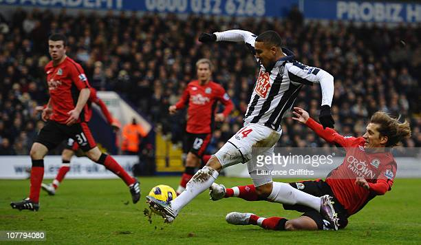 Jerome Thomas of West Bromwich Albion scores the equalising goal under pressure from Michel Salgado of Blackburn Rovers during the Barclays Premier...