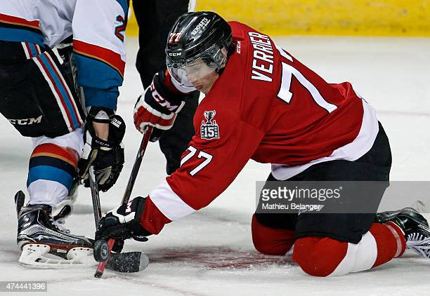 Jerome Verrier of the Quebec Remparts takes a faceoff during the third period in Game One of the Memorial Cup at the Pepsi Coliseum on May 22 2015 in...