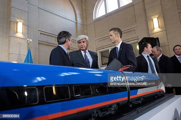 Jerome Wallut , President of Alstom Transportation Inc., speaks with people after an event to unveil a new high speed train at Amtrak's Joseph R....