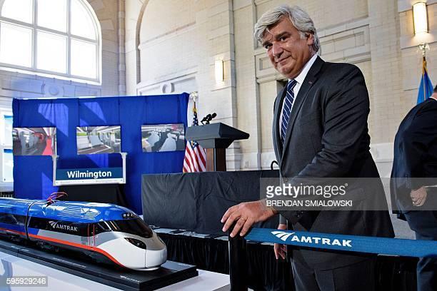 Jerome Wallut, President of Alstom Transportation Inc., takes his seat to hear US Vice President Joe R. Biden speak at Amtrak's Joseph R. Biden, Jr.,...