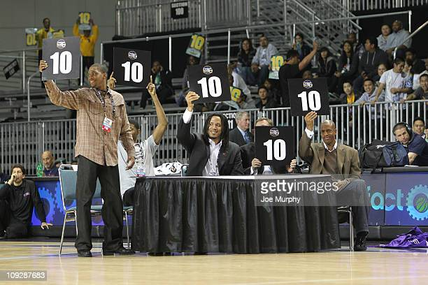 Jerome Williams Don Nelson Brian Grant Paul George and Tony Douglas judges of the ThreePoint Competition show their score during the ThreePoint...